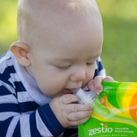 baby with Zestio Pouch Topper